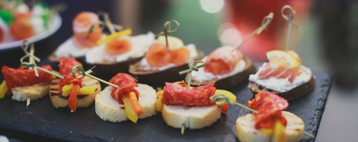 image of custom appetizers on bread and served on a stone dish