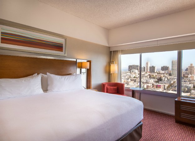 View of our king guest rooms, looking out the window to our city view
