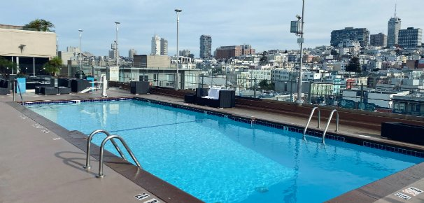 Our roof top pool showing skyline view and ADA accessible lift