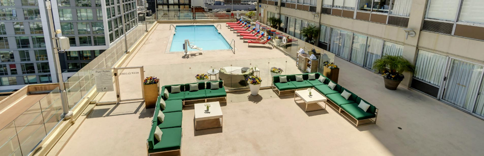 Our roof top pool and sun deck sitting area, showing lounge chairs and pool lift.