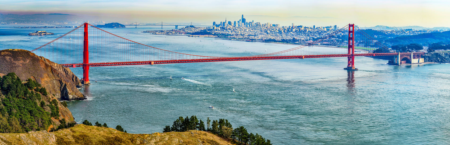 aerial image of the golden gate bridge and san francisco bay in the day time