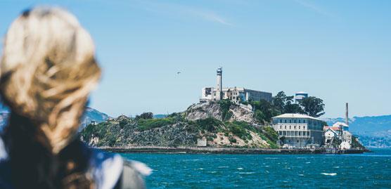 image of a woman looking over san francisco bay to alcatraz island