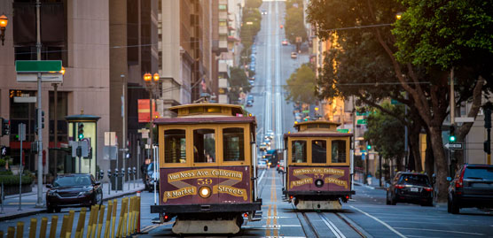 two cable cars side by side on a san francisco street