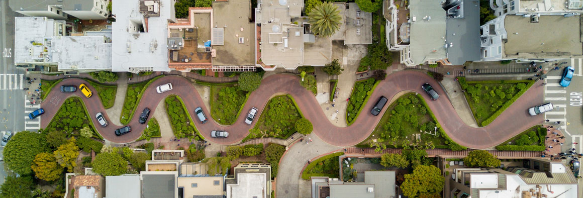 aerial image of lombard street showing twisting road with cars on it