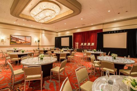 our crystal ballroom showing banquet set up for 5 with stage and screens
