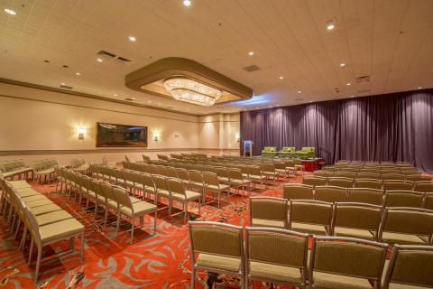 our emerald ballroom showing set up theater style with stage