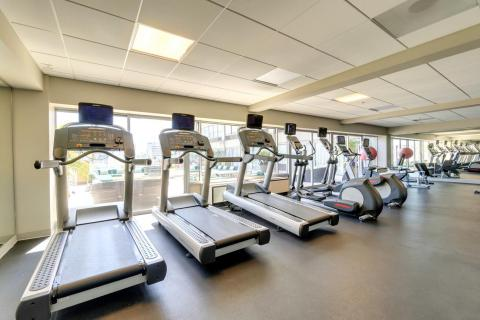 our fitness center showing treadmills and weight machines