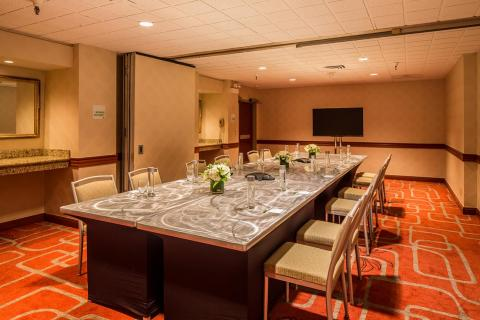 our monterey carmel meeting room showing conference table set up and opened airwall
