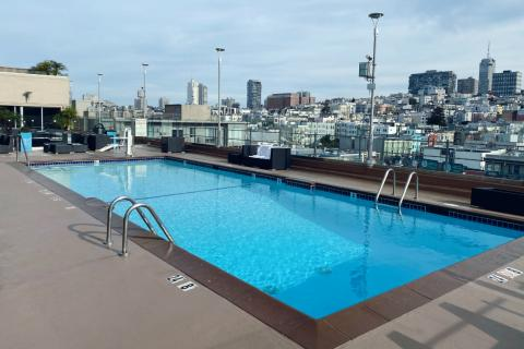 close up of our ADA accessible roof top pool showing skyline view