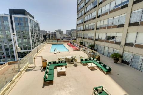 panoramic view of our ADA accessible pool and sun deck with couches
